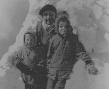 standing to the right of my brother and father by the